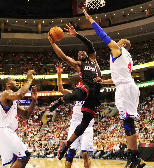 Miami Heat guard Dwyane Wade slices his way through the Philadelphia 76ers' defense during the Heat's 86-82 defeat in Philadelphia in Game 4 of the Eastern Conference quarterfinals.  Even with the victory, Philadelphia still trailed 3-1 in the series.