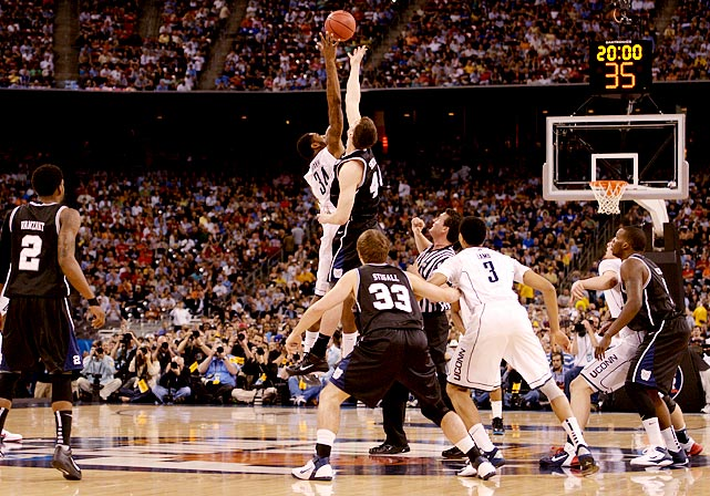 "Two miraculous tournament runs led to the unlikeliest of title games -- but Monday's showdown in Houston was historic for different reasons. ""March Madness"" lived up to its moniker as Butler made its second straight appearance in the championship game, but just like last year, the underdog's efforts ultimately fell short. Behind Kemba Walker and a stifling defense, the Huskies held the Bulldogs to the worst shooting percentage in title game history, a woeful 19 percent, and clawed their way to a 53-41 victory. The win gave Jim Calhoun his third career NCAA title, something only four other coaches have done in history.   Click through our gallery to check out SI's best photos from the 2011 title game ..."