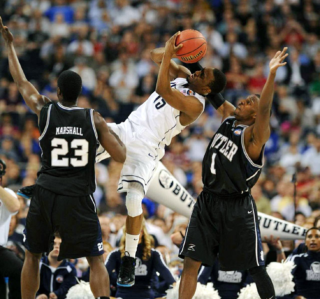 With Butler's defense zoning in on him, UConn star Kemba Walker attempts an unconventional shot in the first half.