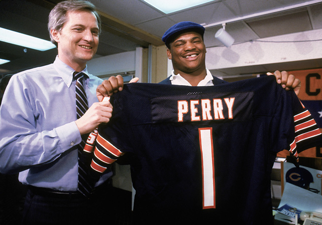 The Fridge, pictured here with Bears' president Michael McCaskey, made an instant impact of the Bears, who drafted him in the first round. He started nine games and had five sacks as a rookie. More famously, he ran in a touchdown that season in Chicago's 46-10 drubbing of New England in the Super Bowl.