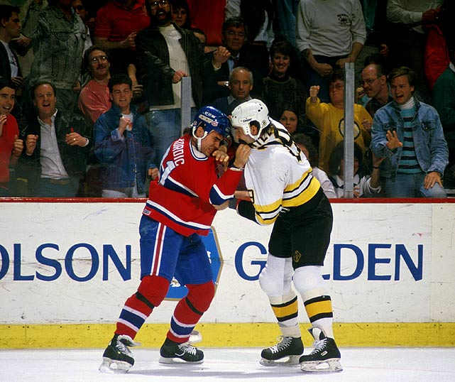 After the final horn sounded in the Habs' 3-2 win in Boston, the rival squads crossed paths on the way to their dressing rooms and fists started to fly. The liveliest bout was between Bruins enforcer Jay Miller and Montreal's John Kordic and the mayhem resulted in $25,000 fines for each team. The scene was so chaotic that Canadiens' GM Serge Savard came down to the bench to order his players into the locker room.  Click here to watch the video.