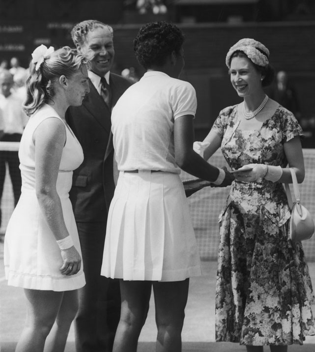 Queen Elizabeth II presents Althea Gibson with a trophy after Gibson beat Darlene Head (6-3, 6-2) in the women's singles final at Wimbledon.