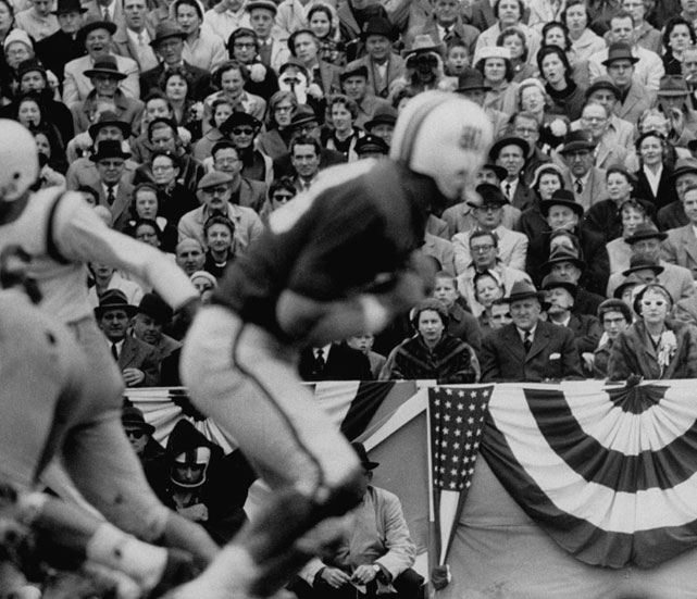 Queen Elizabeth II has a front row for a 1957 college football game between Maryland and North Carolina.