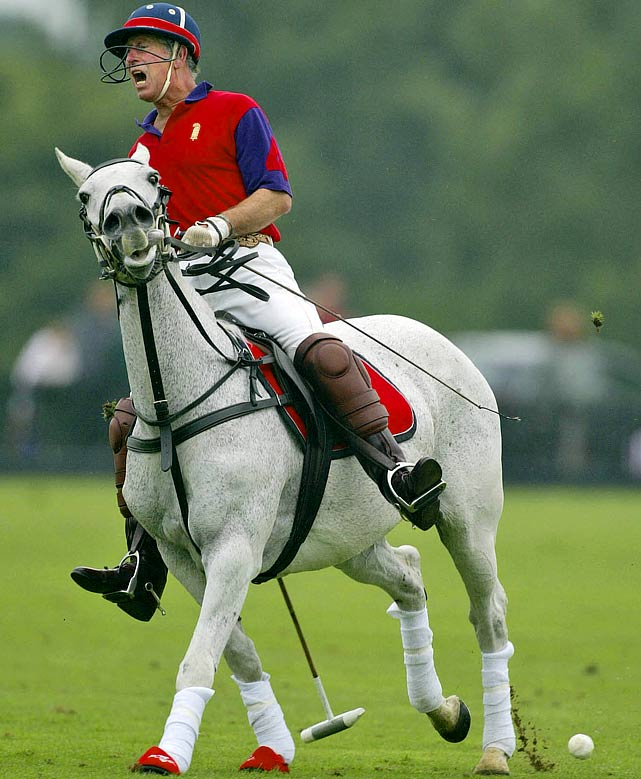 Prince Charles reacts after missing a shot during a polo match at The Queen's Ground, Guards Polo Club in Windsor, England.