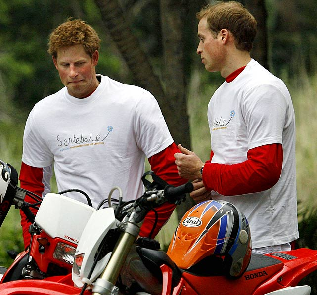 Prince Harry and Prince William pose for photographers before the start of the Enduro Africa charity ride in Port Edward, South Africa.