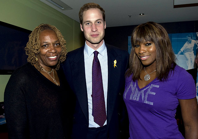 Prince William, Serena Williams (and her mother Oracene) pose at the Rod Laver Arena on Day 4 of the Australian Open in Melbourne.