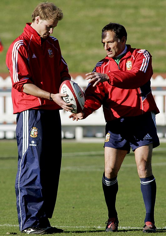 Prince William is shown the correct way to hold a rugby ball for kicking by British and Irish Lions kicking coach Dave Alred in Wellington, New Zealand.