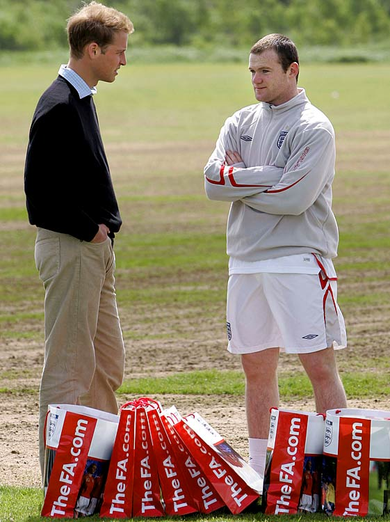 Manchester United striker Wayne Rooney meets Prince William at Carrington training ground near Manchester, England.