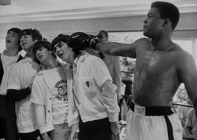 The boxer pretends to use George Harrison's head as a punching bag.
