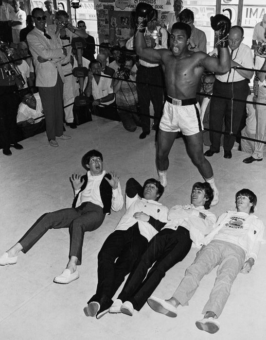 In February 1964, the Beatles took America by storm, and rock 'n' roll was never the same. SI takes a look back at the 50 year relationship between The Beatles and sports. In this photo, Cassius Clay (later known as Muhammad Ali) flays his chest Tarzan Style, the Beatles lie on the floor. The band visited Clay at his training camp in Miami before his fight with champion Sonny Liston. The 22-year-old, trash-talking challenger upset Liston on Feb. 25, a week after this photo was taken.