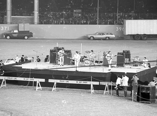 The Beatles perform at Shea Stadium in New York in 1965.