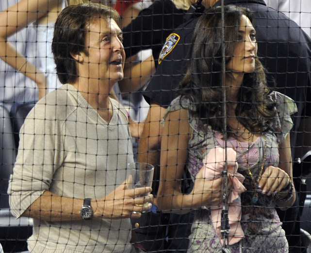 The former Beatle and his now-fiance stand for the seventh inning stretch at Yankee Stadium. Shevell, a New York businesswoman, and McCartney dated for four years before he popped the question -- reportedly with a vintage Cartier solitaire diamond engagement ring worth $650,000.