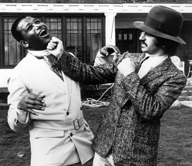 Ringo Starr throws a fake punch at the boxing champion during a break in the filming of Candy