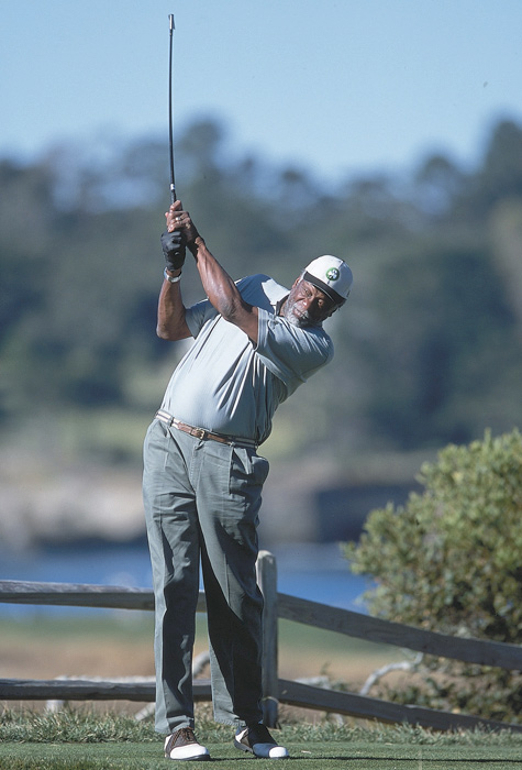 Russell shows off his golf stroke at the Pebble Beach Pro-Am in 2001.