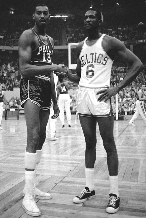 Wilt Chamberlain shakes hands with Russell in 1959. The rivals battled repeatedly in the postseason, with Russell's team usually coming out on top.