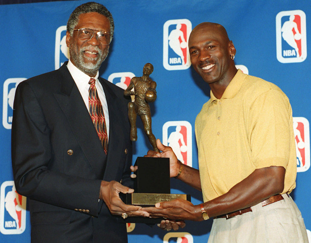 The Celtics great poses with Jordan in 1998 as the Bulls star receives his fifth MVP award. Russell also won the award five times, including three straight, beginning in 1960-61.