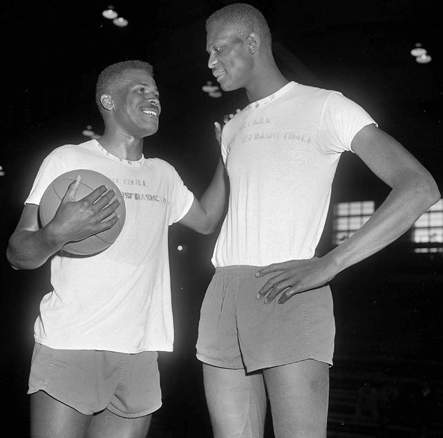 San Francisco teammate K.C. Jones wishes Russell good luck before the 1956 NCAA tournament semifinal game against Southern Methodist. Jones was one of the stars of the 1955 championship team, but he was ineligible in 1956. It didn't matter. Russell led the squad to a repeat championship as it went 29-0.