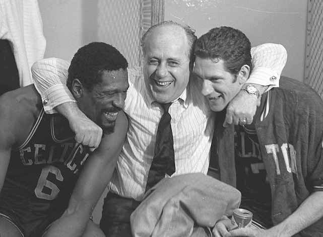 The stress of the 1967-68 season wore on Russell, then serving as player-coach. The assassination of Martin Luther King, Jr. on April 4, a month before this photo was taken, is said to have weighed on Russell, too. But the Hall of Famer flashed a smile alongside longtime coach Red Auerbach and teammate John Havlicek after the Celtics beat the Lakers for the NBA title, ending a tumultuous year.