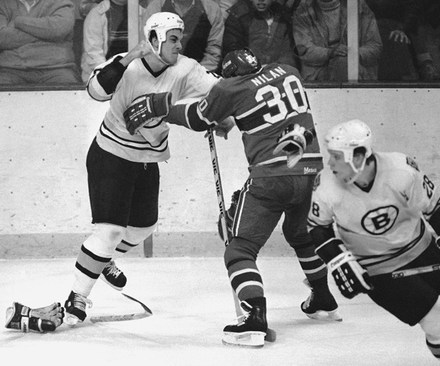 Left wing Luc DuFour prepares to deliver a punch during a fight with Montreal's notorious enforcer Chris Nilan. DuFour spent the first two seasons of his NHL career with the Bruins, totaling 35 points in 114 games.
