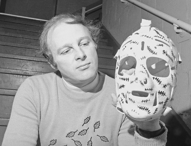 "The Bruins goalie known as ""Cheesy"" shows off his iconic facemask, which he decorated to represent the stitches he would have needed if not for the protection it afforded. The Hall of Famer was crucial to the Bruins' Stanley Cup titles in 1970 and 1972, going 18-3 in his playoff starts during those two seasons."