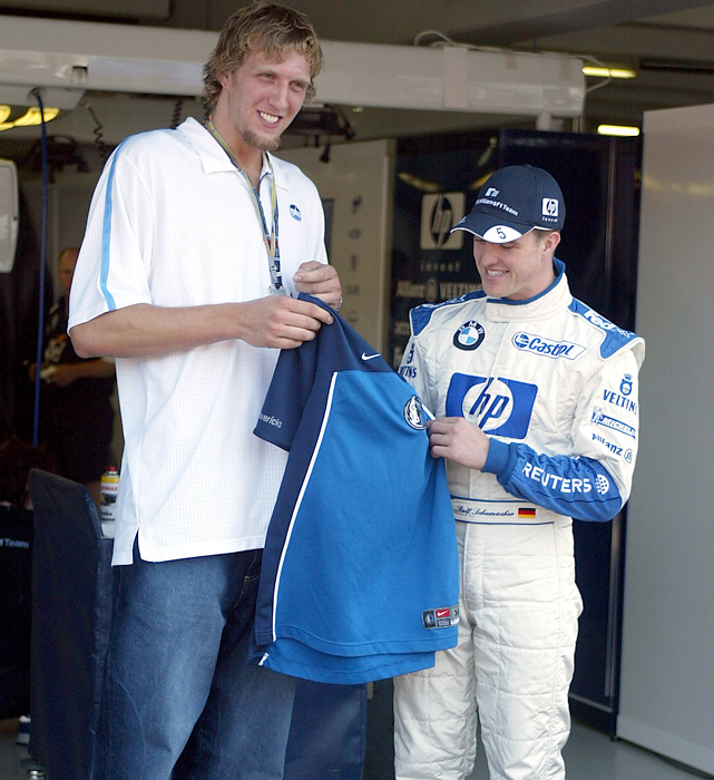 Nowitzki chats with BMW driver Ralf Schumacher before the German Formula One Grand Prix. Schumacher finished third in the race.
