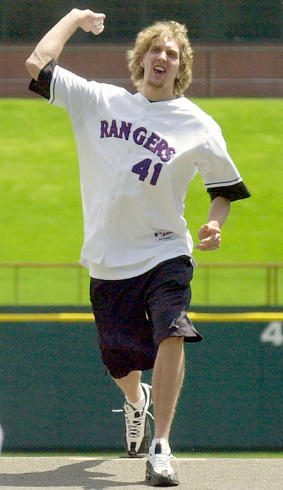 The 7-foot righthander throws out the ceremonial first pitch to teammate Steve Nash before a Mariners-Rangers game in 2003.