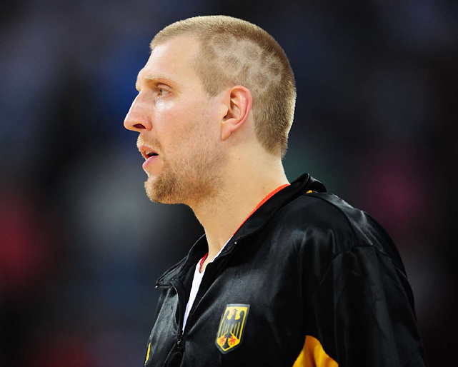 Dirk displays a fitting hairdo in Germany's Olympic opener against Angola. The Olympic rings didn't help his team, though. Germany won only one game and failed to make it out of pool play.