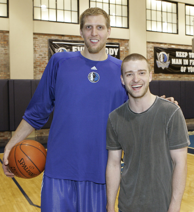 Dirk poses with singer Justin Timberlake after a game of HORSE following a Mavericks game against the Nets in March.