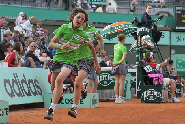 Ball boys run during the first day of play at the French Open.