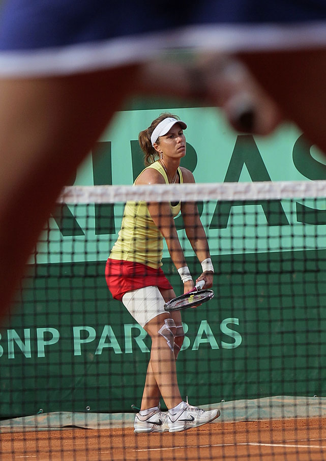 American Varvara Lepchenko is seen serving between the legs of Italy's Flavia Pennetta during their first-round match. Lepchenko won 6-3, 2-6, 6-3 over the 18th-seeded Pennetta, advancing to meet compatriot Bethanie Mattek-Sands in the second round.