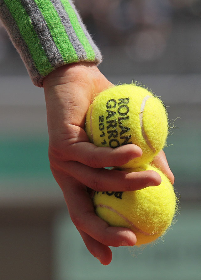 A ball boy holds official balls during the first day of the French Open at Roland Garros.