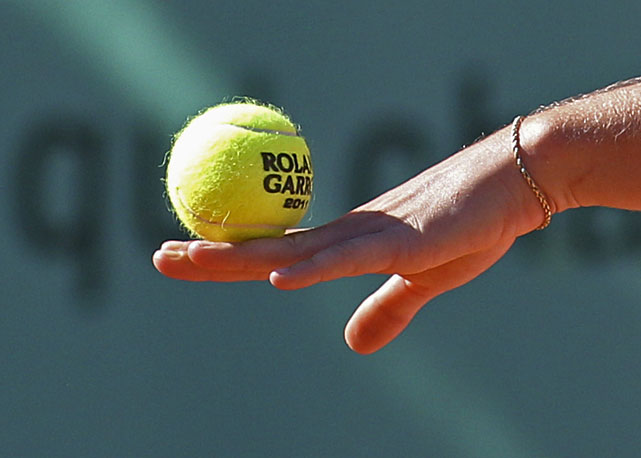 Coco Vandeweghe of the United States balances the ball on her fingers during her match with Maria Kirilenko.