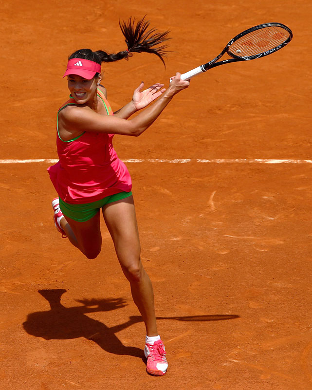 Ana Ivanovic of Serbia plays a forehand during her first-round match with Johanna Larsson of Sweden.
