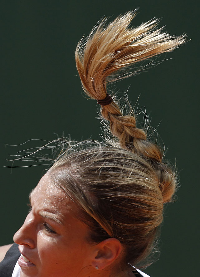 Dominika Cibulkova of Slovakia serves during her match against Vania King of the United States.