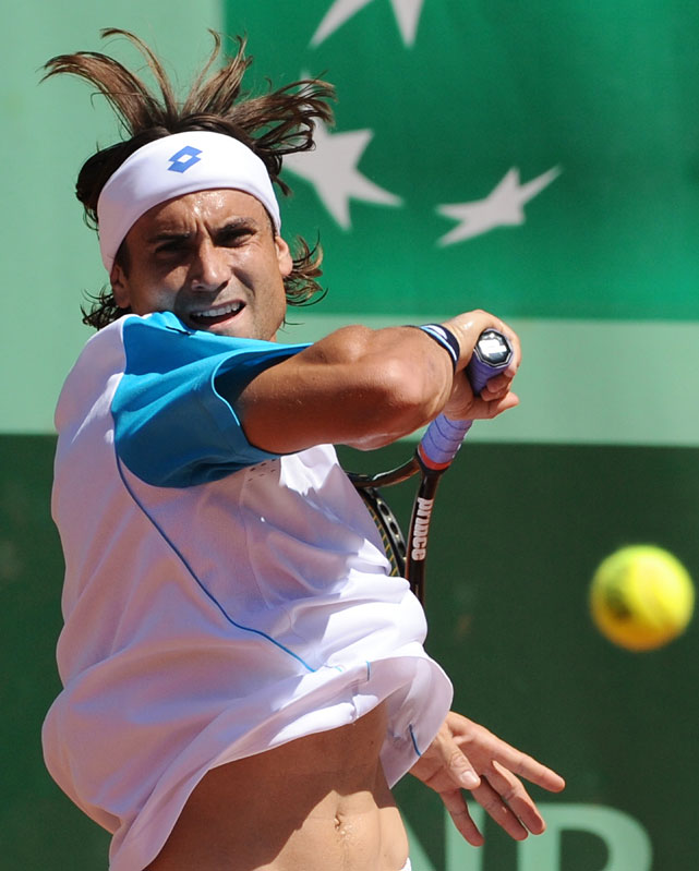 Spain's David Ferrer returns the ball to France's Julien Benneteau. Ferrer won in straight sets.