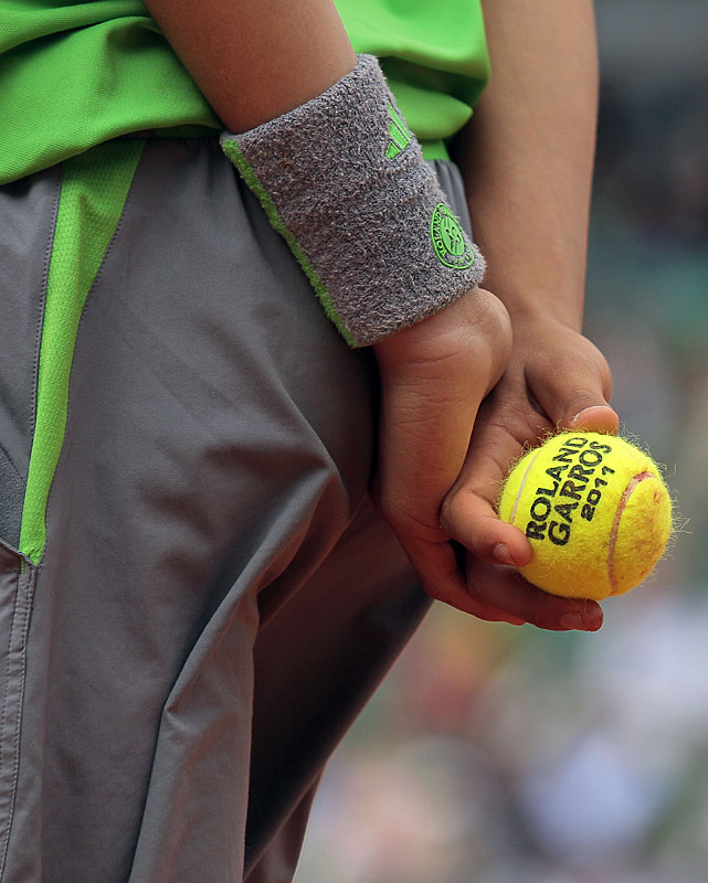 A ball boy awaits a point at the French Open.