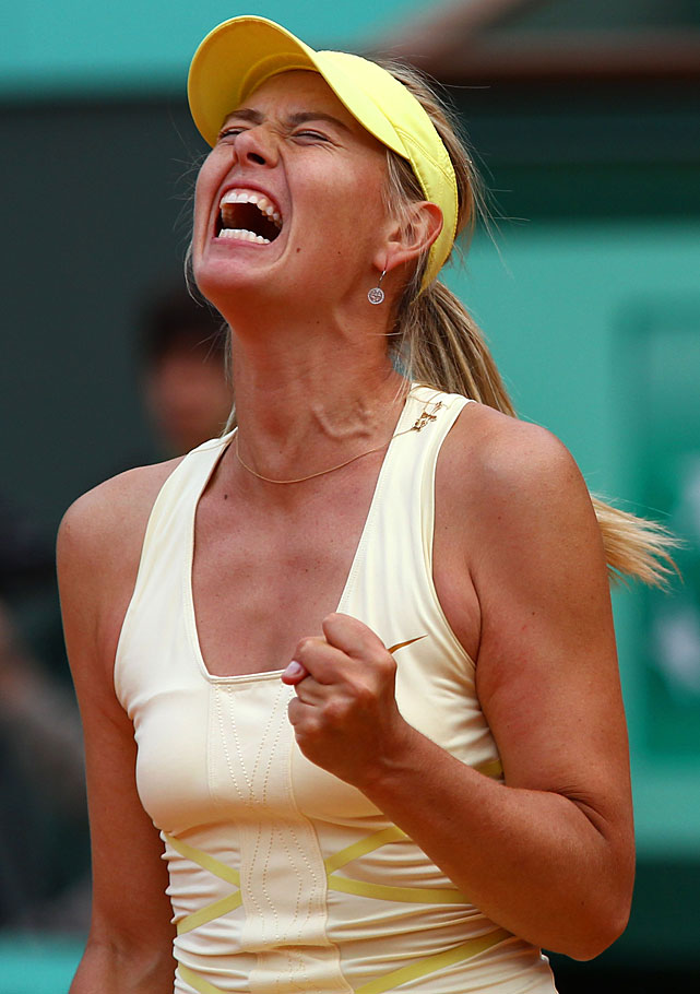 Maria Sharapova celebrates a point during her second-round match with France's Caroline Garcia. Sharapova won the last 11 games of the match to rally for a 3-6, 6-4, 6-0 victory.