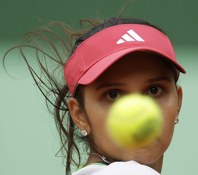 India's Sania Mirza eyes the ball during her second-round match with Poland's Agnieska Radwanska. Mirza lost 6-2, 6-4.