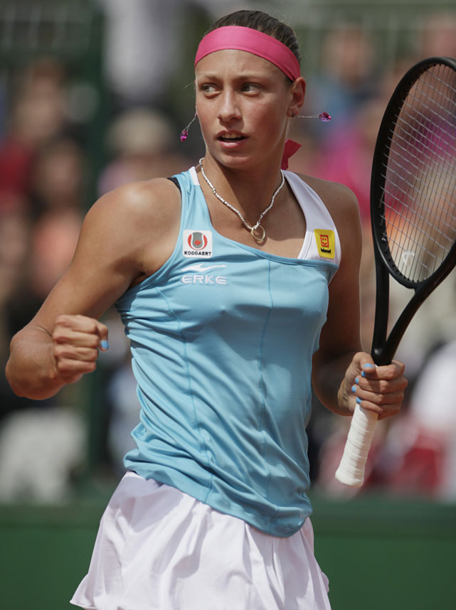 Yanina Wickmayer of Belgium clenches her fist after scoring a point during her second-round match with Ayumi Morita of Japan. Wickmayer won 6-4, 7-5.