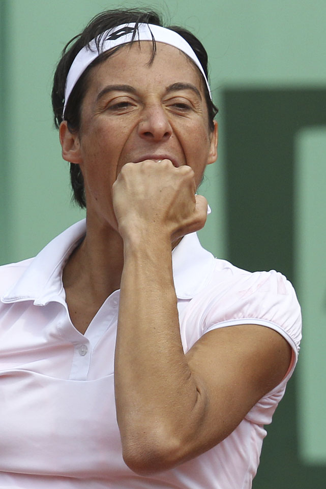 Francesca Schiavone bites her hand after missing a return against Peng Shuai in Friday's third-round match. Peng retired with Schiavone ahead 6-3, 1-2.