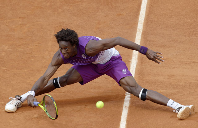 France's Gael Monfils returns the ball to Belgium's Steve Darcis during their third-round match. Monfils prevailed 6-3, 6-4, 7-5.