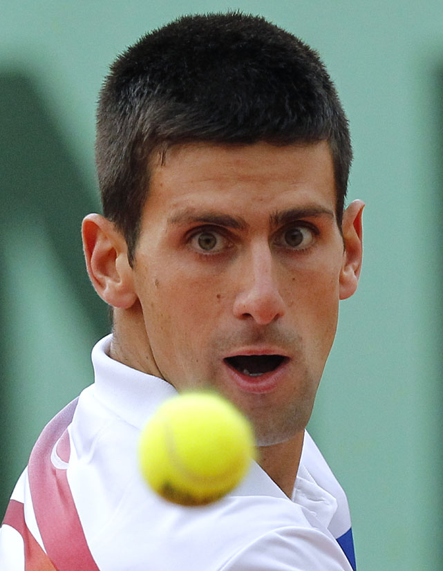 Serbia's Novak Djokovic returns the ball to Argentina's Juan Martin del Potro during their third-round match. Play was suspended for darkness with the match knotted at one set apiece.
