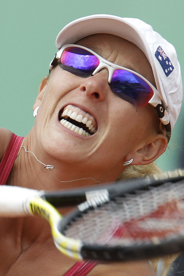 Australia's Anastasia Rodionova returns against Vera Zvonareva of Russia. Rodionova lost 6-2, 6-3.