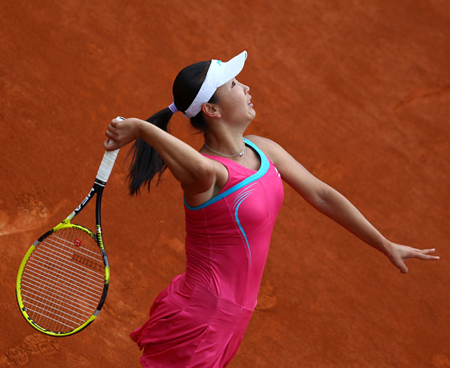 Shuai Peng serves to Francesca Schiavone during their match.