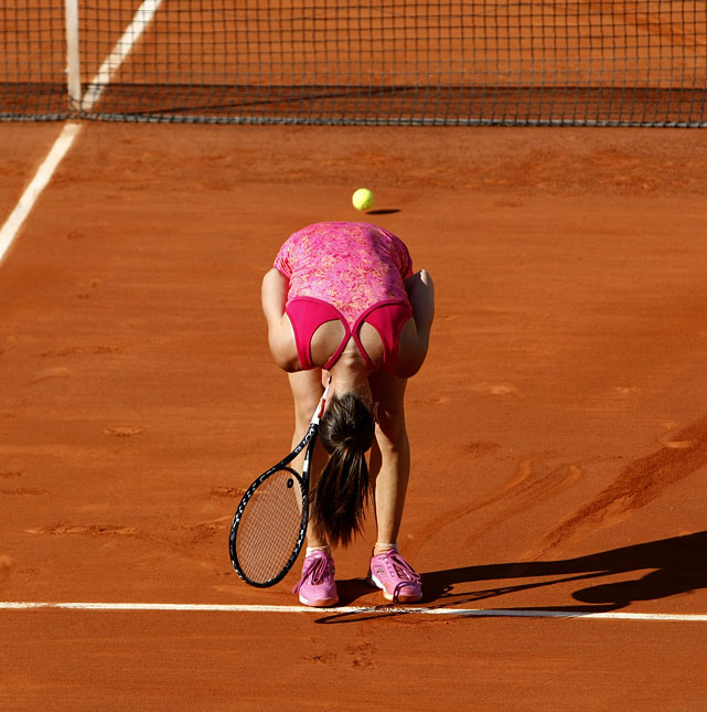 Jelena Jankovic agonizes over a lost point during her match with Francesca Schiavone.