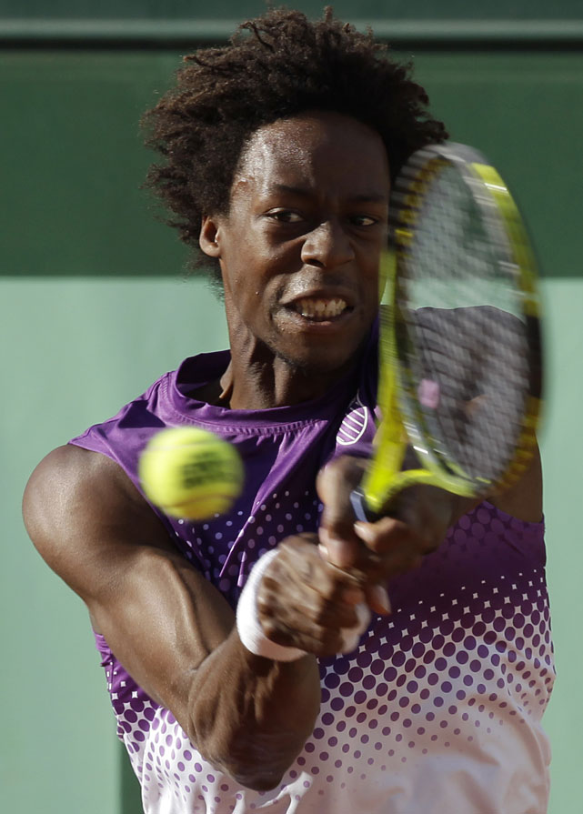 France's Gael Monfils returns the ball to Spain's David Ferrer during their fourth-round match.