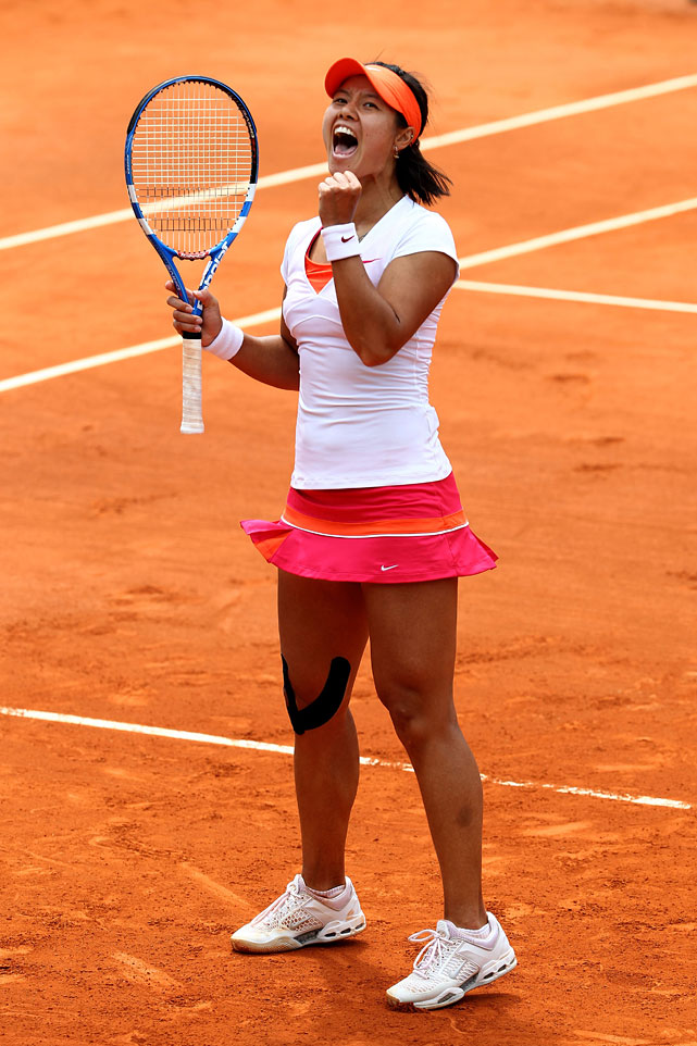 China's Li Na celebrates match point after her 2-6, 6-1, 6-3 victory over Petra Kvitova of the Czech Republic.