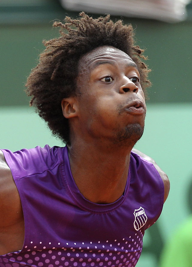 France's Gael Monfils reacts as he plays Spain's David Ferrer during their fourth-round match. Monfils won 6-4, 2-6, 1-6, 7-6(5), 6-2.