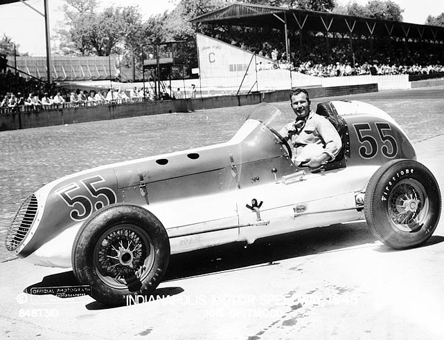 The driver is shown at Indianapolis Speedway, where he would finish 17th in the Indy 500 after being forced out with a fuel leak on 139th lap. Chitwood raced the Indy 500 seven times, and he was the first driver to wear a safety belt at the event.