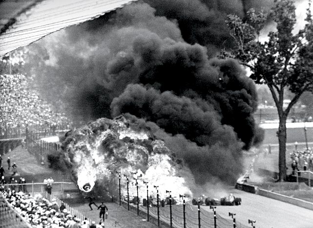 Drivers Eddie Sachs and Dave MacDonald were killed in this crash on the second lap of the Indy 500. Here, a burning tire flies toward spectators near Turn 4 as a gas tank explodes.